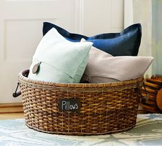 Keep a big basket next to or at the foot of your bed for tossing throw pillows and other decorative items when it's time to sleep.