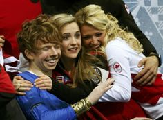 """Kevin Reynolds of Canada celebrates in the """"kiss and cry"""" area with teammates during the Team Men Free Skating Program at the Sochi 2014 Win..."""