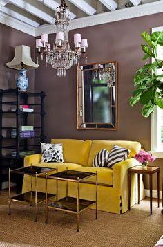Brown wall w/yellow, animal print, sisal rug, a bl/wht vase