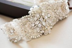 Beaded bridal sash - Style S58 * Hand beaded on fabric * Colors = Ivory, offwhite beading Length of the beading is about 15 inches and max width in the center is about 3 inches. The design tapers on e