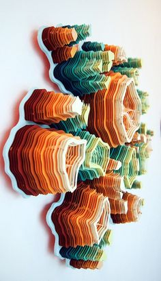Hand cut paper sculptures.