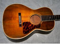"Vintage 1931 Gibson L-2 acoustic guitar in rare ""argentine gray"" sunburst."