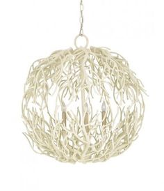 Constructed from wrought iron and with a textured white coral finish, the Eventide Sphere Chandelier from Currey & Company is a symbol of coastal beauty. Reminiscent of the spindly roots of the Mangrove tree, the Eventide Chandelier's delicate shape allows the lights within to shine through, providing an ethereal glow.