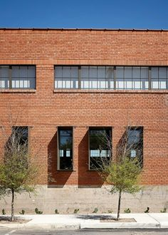 Window shades, brick Hughes Warehouse Adaptive Reuse / Overland Partners