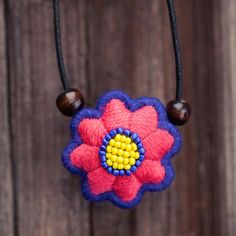 Eight petalled flower embroidery Flower necklace a by Aipiyi, $35.00