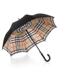"""I want this Burberry umbrella. If I'm gonna go out in the rain, I want to feel good about it. Everytime I would look up at the Burberry plaid inside of the umbrella as I walked along; I would be """"Singin In The Rain"""". Biddy Craft"""