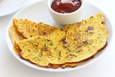 """These very thin chickpea flour pancakes are a traditional Indian breakfast that can also be enjoyed as a snack or side. Vegan, gluten-free, """"omelet"""" option."""