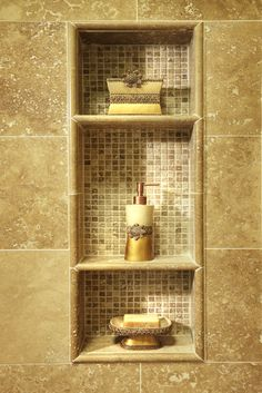 I like the shower shelves in-set between the wall studs and then tiled. What a space saver.