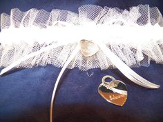 Bridal garter with engravable heart. Such a cute idea! Find these at The Prince's Table!
