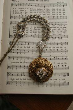 Vintage medallion, bracelet pieces, rhinestones. So cool.