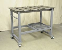 Segmented welding top for clamping things to it New Welding Table - WeldingWeb™ - Welding forum for pros and enthusiasts Welding Table, Welding Cart, Welding Shop, Diy Welding, Metal Welding, Welding Ideas, Welding Workshop, Metal Workshop, Workshop Storage
