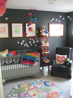 "Love this color scheme for a gender neutral nursery... could add more pinks and purples if baby is a girl or more greens and blues for a boy later! But I love the rainbow quilt and cute pillows. Perfect for a creative kiddo ... this is my style! Love the art""sy"" vibe"