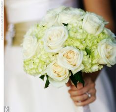 Colleen carried a bouquet of ivory English roses and light green hydrangeas -- a perfect match with the wedding's color palette.