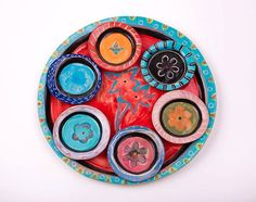 This handmade ceramic Passover plate or Seder plate is a Judauca piece of art that can be used all year long as a set of plates for an appetizer,