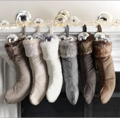 I LOVE the color scheme of these stockings. Its very chic. Filling them with Christmas balls is so smart...