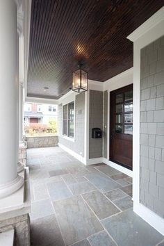 pic 1 of 2. front entry porch. palette: gray, dk. brown, white trim. awesome light fixture, slate tile floor, dark brown ceiling and door, gray siding I Love the ceiling!