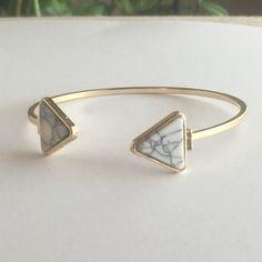 Triangle Cuff Bracelet Antique Gold Plated White Triangle Cuff Bracelet. No trades. No holds. 20% off bundles. Jewelry Bracelets