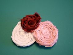 Rolled fabric flowers are all over the internet right now. I have been wanting to make a hair clip for a while and Valentine's seemed like ...