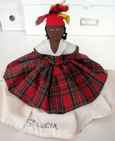 """Caribbean 2002 I purchased this doll on one of the Islands """"St. Lucia"""" as I thought it was interesting as I have never seen a doll like this. This is one side of the doll and then you turn it over and there is another completely different dress and face. Very clever!"""