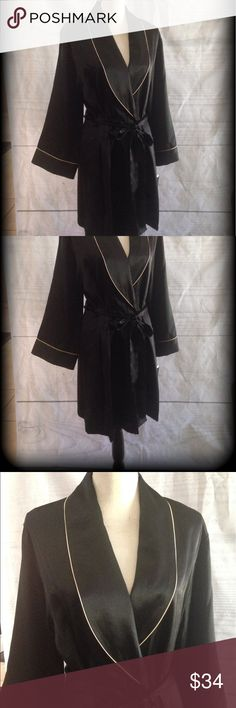 Luxurious Robe 100% polyester, looks and feels like silk. Two pockets. Ties inside as well. Belt is permanently attached in the back. Gold trim on sleeves and collar. Very pretty. Feels great on your skin. See coordinating nightgown and pajama sets in my other posts. Bundle and save! Jones New York Intimates & Sleepwear Robes