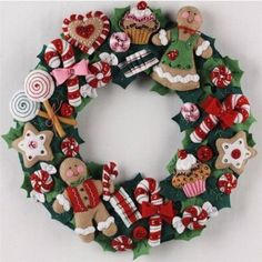 Bucilla ® Seasonal - Felt - Home Decor - Cookies and Candy Wreath. This collection is sure to bring the joy of the season to any room in your home. Christmas Wreath Image, Xmas Wreaths, Felt Christmas Ornaments, Noel Christmas, Christmas Gingerbread, Christmas Cookies, Christmas Projects, Holiday Crafts, Candy Wreath