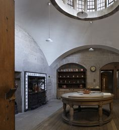 The Kitchen at Castle Drogo, Devon. The room has a Soane-style top-lit pendentive dome, echoed by the circular beechwood table below. ©Natio...