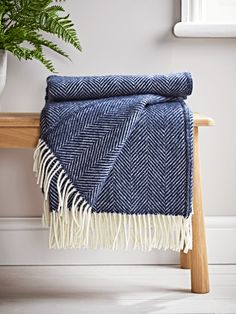 Crafted from pure new wool in a deep shade of navy, our Soft Wool Throw is handwoven in the UK. Finished with elegant cream fringing, it drapes beautifully in your home and warms cold shoulders on chilly evenings.