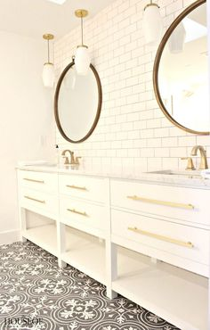White subway backsplash, white bathroom cabinets, gold hardware, cement tile floors. The House of Silver Lining: Extreme Master Bath Makeover