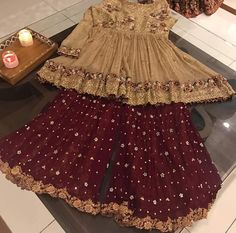Golden and maroon embroidered baby girls sharara dress designs 2018 for wedding party Pakistani Mehndi Dress, Pakistani Formal Dresses, Pakistani Wedding Outfits, Pakistani Dress Design, Bridal Outfits, Desi Wedding Dresses, Wedding Dresses For Kids, Party Wear Dresses, Summer Dresses