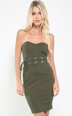 Loving this trendy olive color on this strapless dress. We're obsessed with the lace up detailing on the waist! I MakeMeChic.com