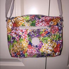 "Kipling cross body bag NWOT Kipling garden party cross body bag. Zippered pockets on front and back. Interior nylon lining. Key fob. Adjustable should strap. 9"" x 6.25"" x 5.5"". Nylon exterior. NWOT. Kipling Bags Crossbody Bags"