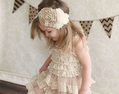 Our vanilla ivory lace quarter sleeve flower girl dress is perfect for any rustic chic occasion.  Delicate lace covers the entire dress, and