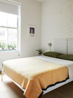 In their Chelsea, Manhattan apartment, Noam Dvir and Daniel Rauchwerger DIY-ed a headboard from acoustic panels.