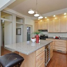 Kitchen with maple cabinets granite counter tops and red oak