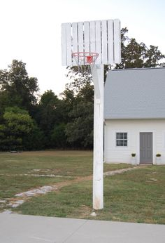 Kids love the Hoosiers-style basketball goal made with salvaged utility pole and cantilevered wood pallet. Pool Basketball, Basketball Goals, House Near Mountains, Outside Fountains, Basketball Backboard, Outdoor Play Spaces, Carport Designs, Porch Garden, Fire Pit Patio
