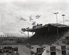 Balloons are released during the opening ceremonies for the World's Fair in Memorial Stadium on April 21, 1962. (George Carkonen / The Seattle Times)