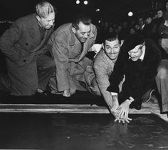 Clark Gable at his hand and footprint ceremony at Grauman's Chinese Theater