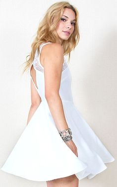 White swan dress via Misslia STHLM. Click on the image to see more!