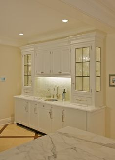 white cabinets on wet bar in kitchen