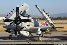 Douglas A-1D Skyraider (AD-4NA) NX409Z / 126997/JC-409 (cn 7797) Chino Planes of Fame Air Show 2015 - The Skyraider rests up for the evening with wings folder after the days programmed aerial performances. This was a first for me, to have seen this type in the skies.