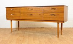 Sleek Mid Century Teak Veneer Danish Inspired by ModCenturyVintage, $995.00
