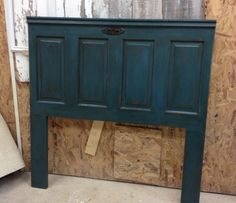 Headboard from vintage door painted ASCP Aubusson Blue. LOVE!!!