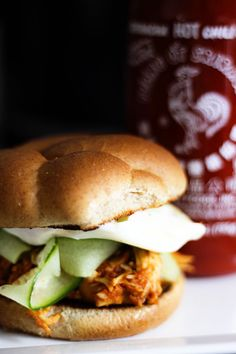 Slow-Cooker Honey Sriracha Barbecue Chicken Sandwiches | Sauce: Ketchup, onion, garlic, honey, Sriracha hot sauce, rice vinegar, soy sauce, toasted sesame oil. Combine sauce and chicken in slow cooker. Sandwiches: Sriracha chicken, English cucumber, cilantro, fried egg, whole wheat bun.