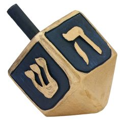 The dreidel is a 4-sided wooden or clay top that has a Hebrew letter on each side. Description from wheatandtares.org. I searched for this on bing.com/images