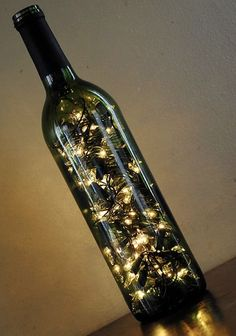 The glow of white lights emanating from a wine bottle creates the perfect ambience Easy and a great way to set the mood.