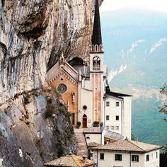 Santuario Madonna Della Corona (Sanctuary of the Lady of the Crown), Italy. The Church built in 1530, sits right into a vertical cliff, which faces Italy's Mount Baldo.