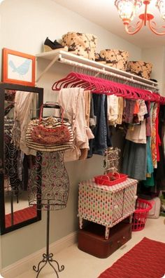 For the walk-in closet-you should get a rack like this to hang for your clothes and then you can put your dresser beneath your clothes.: