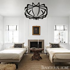 A pair of oversize daybeds lend a sense of symmetry to this showhouse bedroom. - Photo: Werner Straube / Design: Michael Del Piero