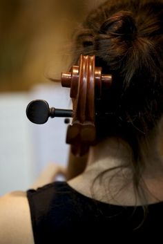 A student playing in the orchestra at UNO (Repinned)