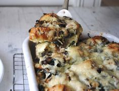 Savory Bread Pudding - (with mushrooms, spinach, leeks and Gruyere. The recipe calls for 1 large baquette. But since it's savory, multi-grain or whole wheat bread might also work nicely.)